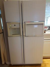 Two door side by side fridge, electric stove and dishwasher.