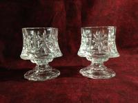 candlesticks and glass votive holders