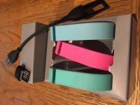 Fitbit Flex bands, charging cable and computer usb