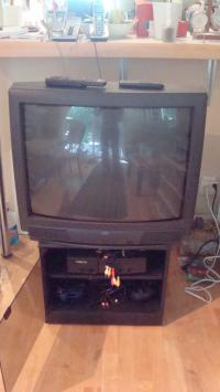 Analog TV, X box with 5 games and TV stand
